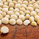 macadamia nuts on rustic wood - PhotoDune Item for Sale