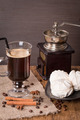 Coffee in glass cup and cinnamon with zephyr - PhotoDune Item for Sale