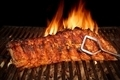 BBQ Roast Baby Back Pork Ribs Close-up On Hot  Grill - PhotoDune Item for Sale