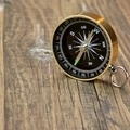Gold Magnetic Compass On The Wood Board - PhotoDune Item for Sale