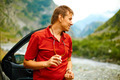 Car and driver man in  mountain landscape - PhotoDune Item for Sale