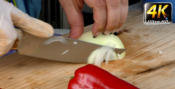 Chopping Onion on Wooden Plate 1