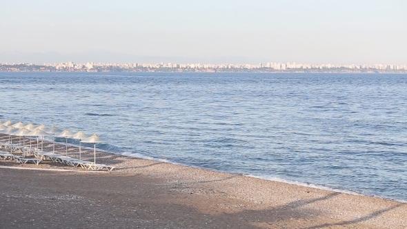 Many Straw Beach Umbrellas At The Seashore In
