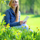 Young woman using tablet in park - PhotoDune Item for Sale