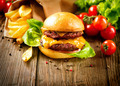 Hamburger with fries on wooden table - PhotoDune Item for Sale