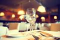 Served dinner table in a restaurant. Restaurant interior - PhotoDune Item for Sale