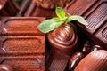 Chocolates background. Praline chocolate sweets - PhotoDune Item for Sale