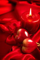 Valentine's Day. Valentine red hearts and candle on red silk - PhotoDune Item for Sale