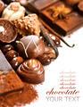 Chocolates border isolated on white background. Chocolate - PhotoDune Item for Sale