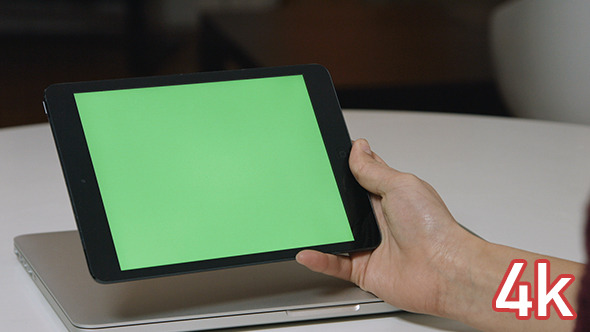 Holding Tablet with Green Screen