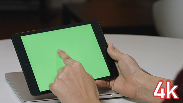 Girl Using Tablet with Green Screen