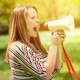 Portrait of middle aged woman shouting using megaphone against a - PhotoDune Item for Sale