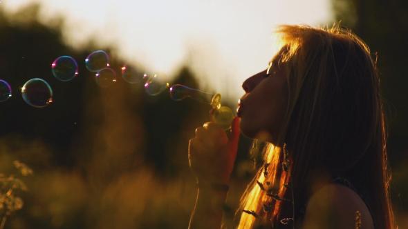 Woman Is Blowing Bubbles
