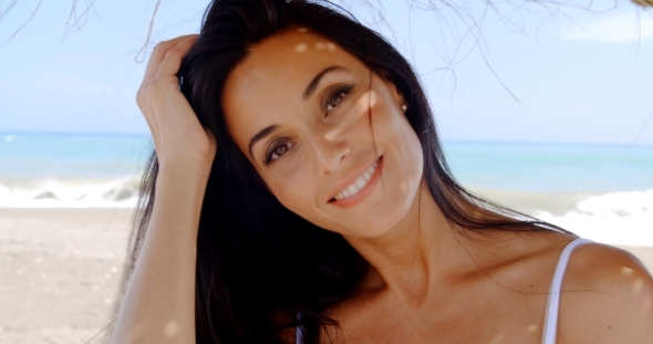 Brunette Woman In Shade On Tropical Beach