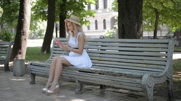 Girl Using Tablet PC in Park