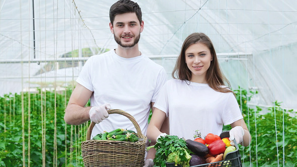 Farmers With A Basket Full Harvest Smiling
