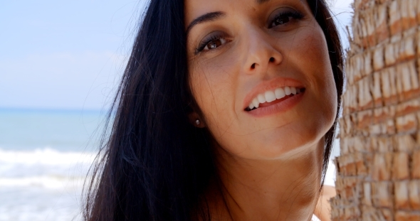 Close Up Woman At The Beach Looking At The Camera