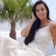 Pretty Woman In White Sitting On Terrace Rail - VideoHive Item for Sale