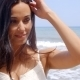 Pretty Young Woman At The Beach Smiling At Camera - VideoHive Item for Sale