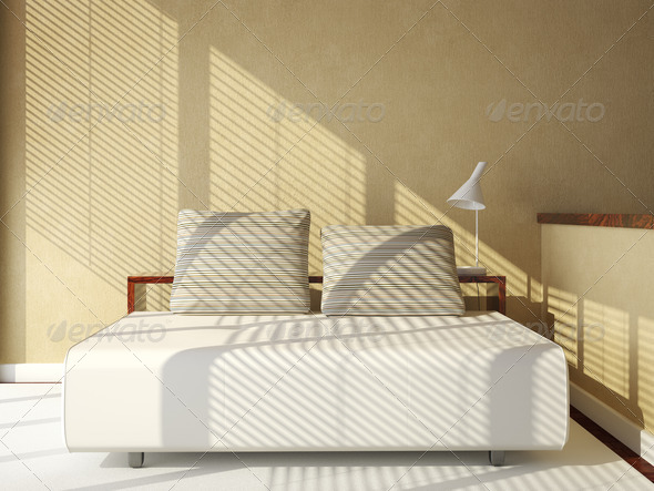 sofa-bed on tan wall - Stock Photo - Images