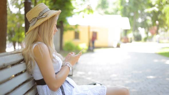 Girl Using Smartphone in Park