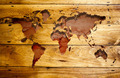 Vintage world map with wood texture.