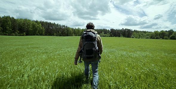 Adventurer Hiking In Beautiful Landscape