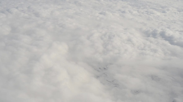 Aerial View from Airplane White Clouds