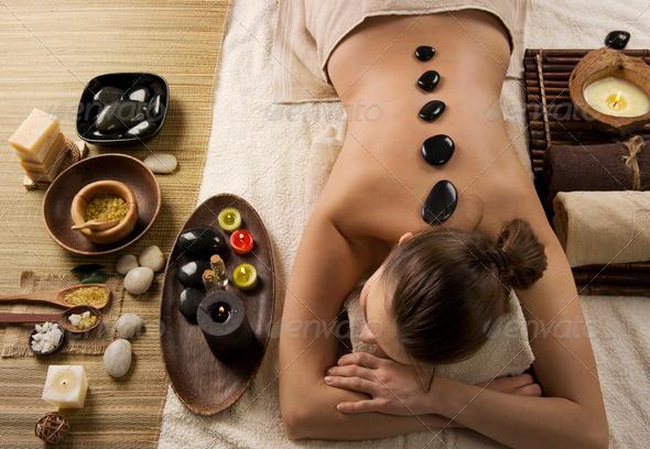 Spa Woman. Hot Stones Massage - Stock Photo - Images