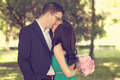 Couple celebrating their marriage in park