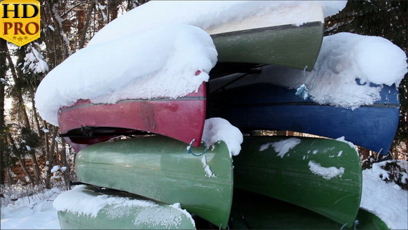 Seven Boats Piled Upside Down with Snow