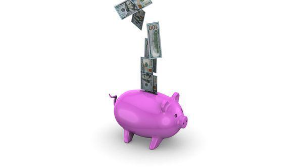 Falling Money in Piggy Bank