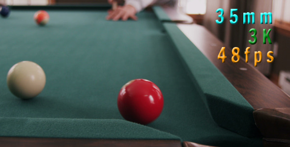 Man In Billiards Shoots Red Ball In Pocket 12