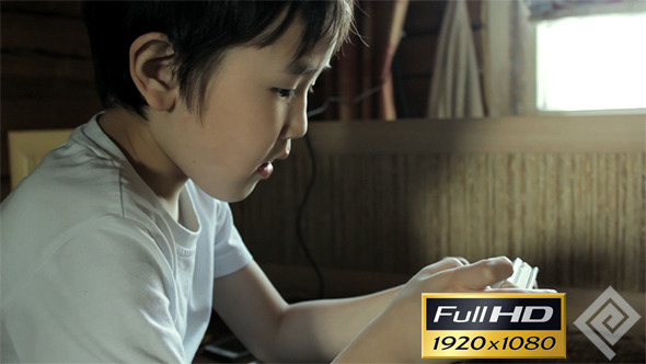 VideoHive Kid Playing On Smartphone #1 11772853