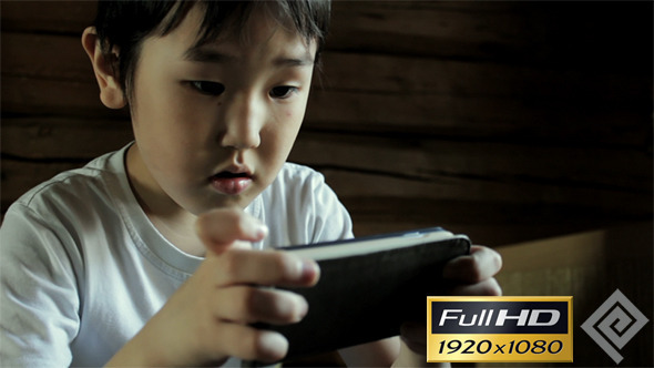 VideoHive Kid Playing On Smartphone #2 11772866