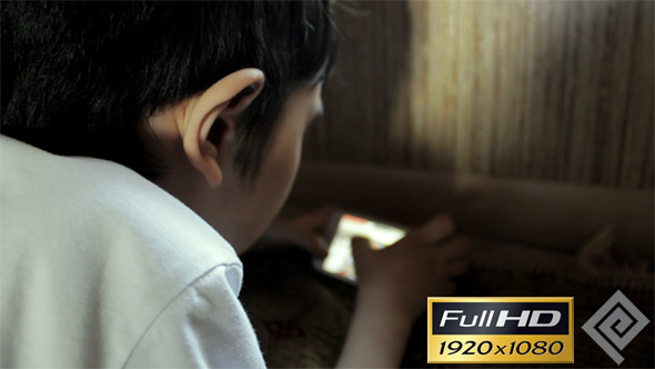 VideoHive Kid Playing On Smartphone #3 11772871