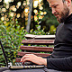 The Young Man Working on a Laptop in the Park - VideoHive Item for Sale