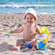 Child Plays on the Sea Beach in the Sand - VideoHive Item for Sale