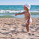 Child Walking on the Sand on  Seashore - VideoHive Item for Sale
