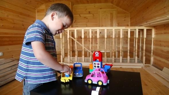 Cute Boy Plaing With Toy Car
