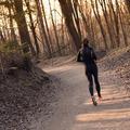 Female runner in the forest.