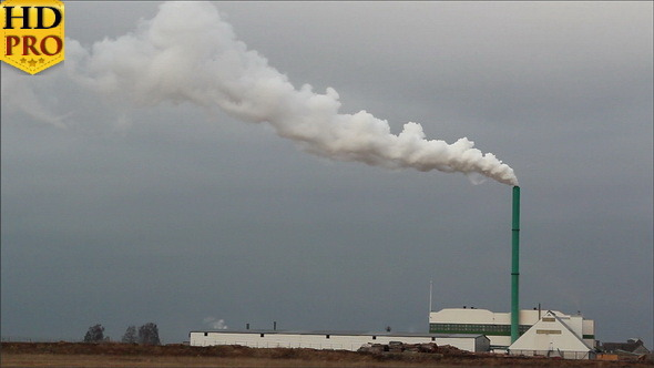 A Factory with White Smoke Release