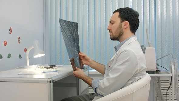 Doctor Looking At The X-ray Picture Of Lungs In