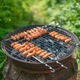 Tasty sausages on round grill. - PhotoDune Item for Sale