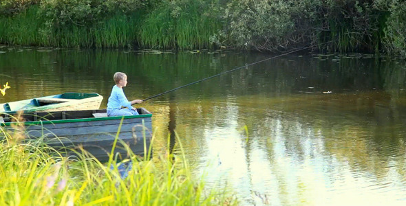 Little Boy Fishing from Boat on River