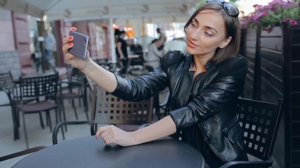 Beautiful Brunette Enjoys Gadget Outdoors