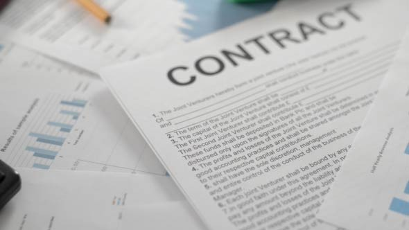 Contract and Documents on Table
