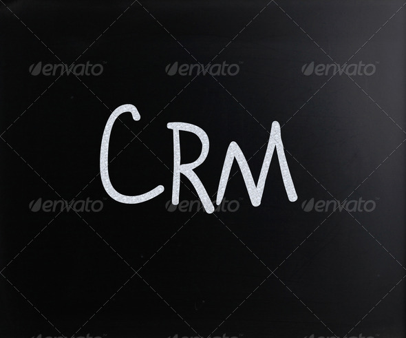 "The word ""CRM"" handwritten with white chalk on a blackboard - Stock Photo - Images"