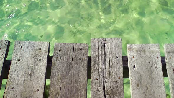 Wooden Pier And Tropical Water