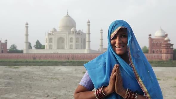 Indian Woman Wearing Sari In Front Of Taj Mahal 5